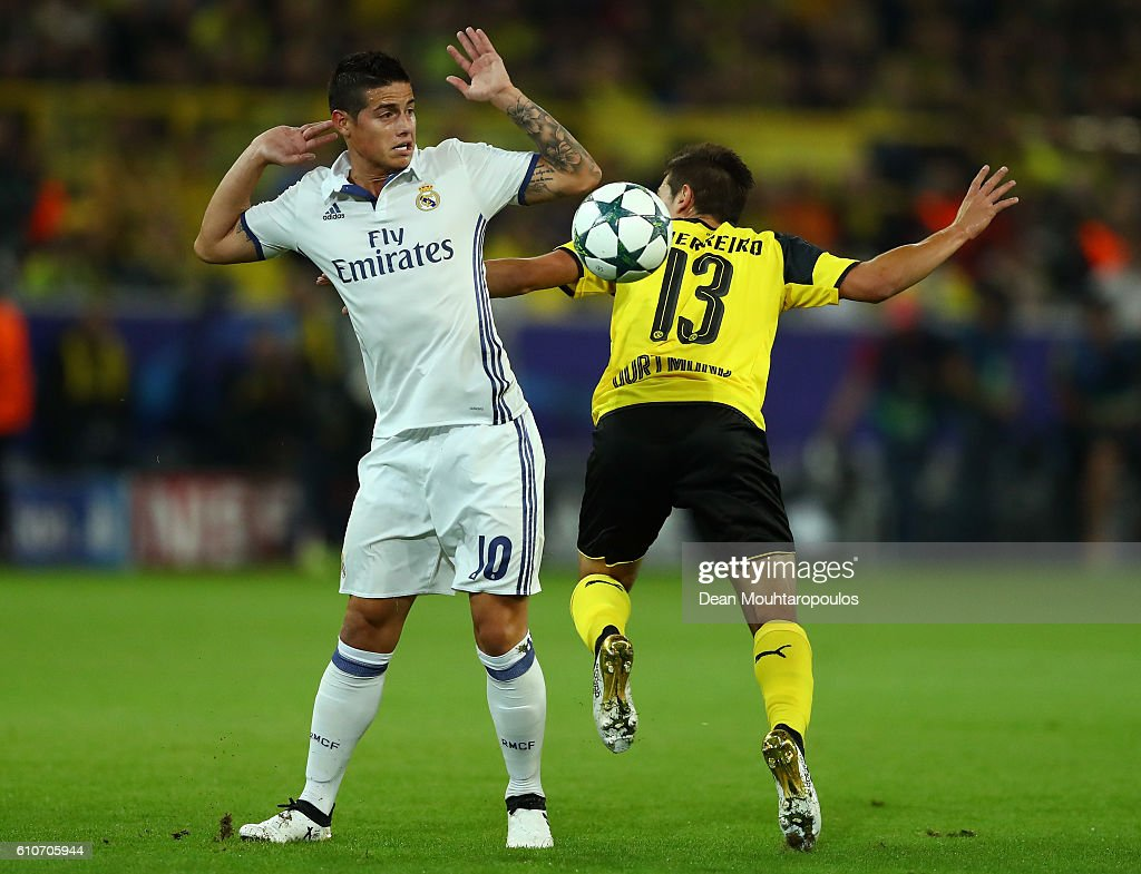 James Rodriguez of Real Madrid and Raphael Guerreiro of Borussia Dortmund battle for the ball during the UEFA Champions League Group F match between Borussia Dortmund and Real Madrid CF at Signal Iduna Park on September 27, 2016 in Dortmund, North Rhine-Westphalia.