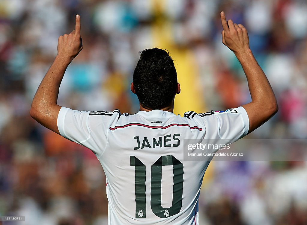 <a gi-track='captionPersonalityLinkClicked' href=/galleries/search?phrase=James+Rodriguez&family=editorial&specificpeople=4422074 ng-click='$event.stopPropagation()'>James Rodriguez</a> of Real Madrid celebrates after scoring during the La Liga match between Levante UD and Real Madrid at Ciutat de Valencia on October 18, 2014 in Valencia, Spain.