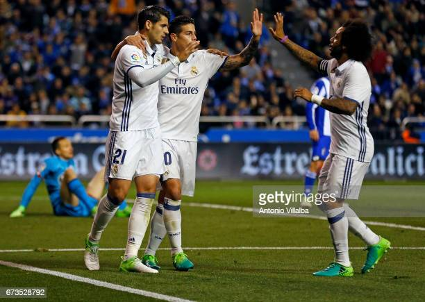 James Rodriguez of Real Madrid celebrates after scoring goal whit his teammates during the La Liga match between RC Deportivo La Coruna and Real...