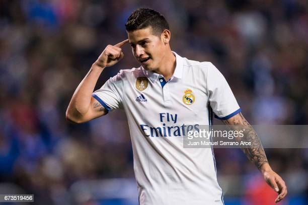 James Rodriguez of Real Madrid celebrates after scoring his team's fourth goal during the La Liga match between RC Deportivo La Coruna and Real...
