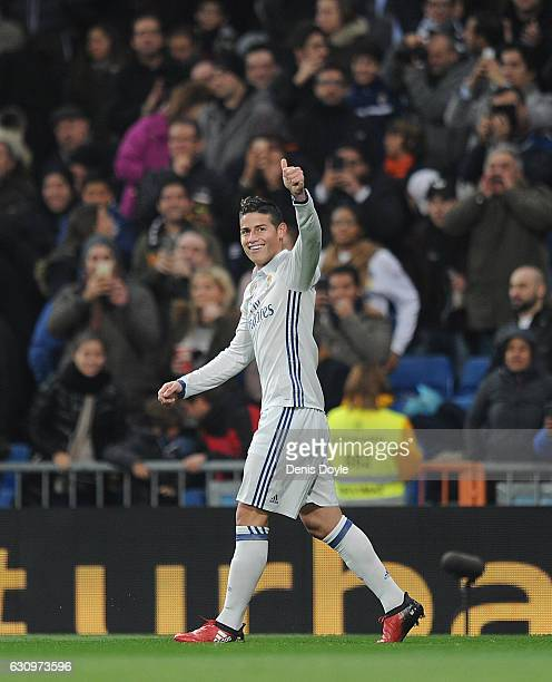 James Rodriguez of Real Madrid celebrates after scoring Real's opening goal during the Copa del Rey Round of 16 First Leg match between Real Madrid...