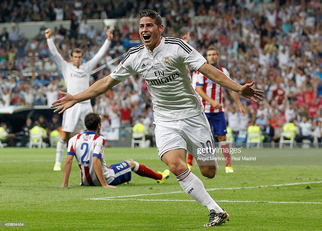 <a gi-track='captionPersonalityLinkClicked' href=/galleries/search?phrase=James+Rodriguez&family=editorial&specificpeople=4422074 ng-click='$event.stopPropagation()'>James Rodriguez</a> of Real Madrid celebrates after scoring the opening goal during the Supercopa first leg match between Real Madrid and Atletico de Madrid at Estadio Santiago Bernabeu on August 19, 2014 in Madrid, Spain.