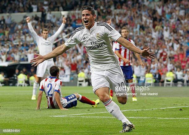 James Rodriguez of Real Madrid celebrates after scoring the opening goal during the Supercopa first leg match between Real Madrid and Atletico de...
