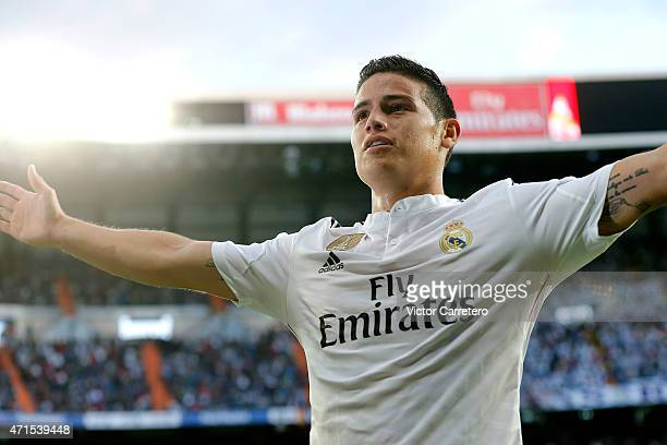 James Rodriguez of Real Madrid celebrates after scoring the opening goal during the La Liga match between Real Madrid CF and UD Almeria at Estadio...