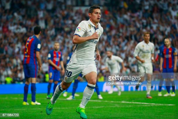 James Rodriguez of Real Madrid celebrates as he scores their second goal during the La Liga match between Real Madrid CF and FC Barcelona at Estadio...