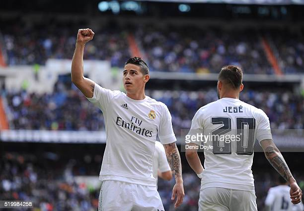 James Rodriguez of Real Madrid celebrates scoring his sid's opening goal during the La Liga match between Real Madrid and Eibar at Estadio Santiago...