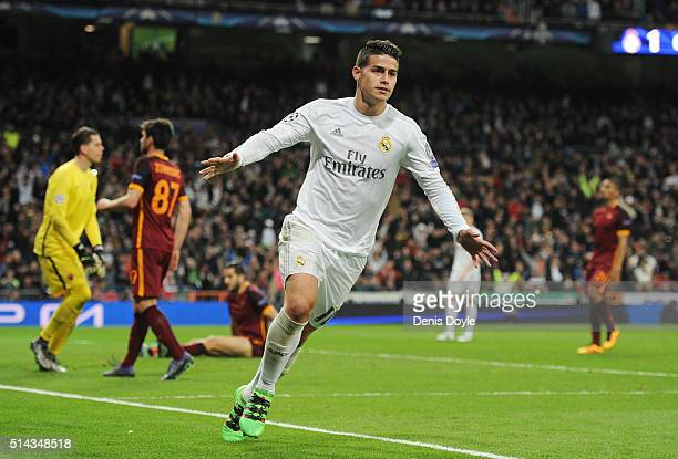 James Rodriguez of Real Madrid celebrates scoring his team's second goal during the UEFA Champions League Round of 16 Second Leg match between Real...