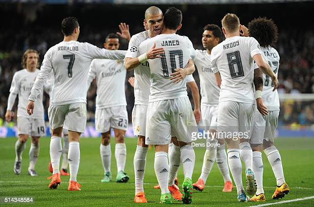 James Rodriguez of Real Madrid celebrates scoring his team's second goal with Pepe during the UEFA Champions League Round of 16 Second Leg match...