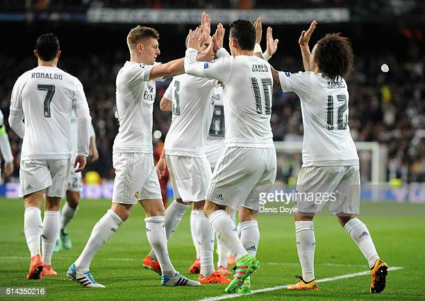 James Rodriguez of Real Madrid celebrates scoring his team's second goal with Toni Kroos during the UEFA Champions League Round of 16 Second Leg...