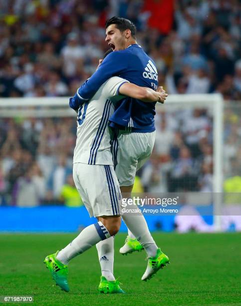 James Rodriguez of Real Madrid celebrates with Alvaro Morata as he scores their second goal during the La Liga match between Real Madrid CF and FC...