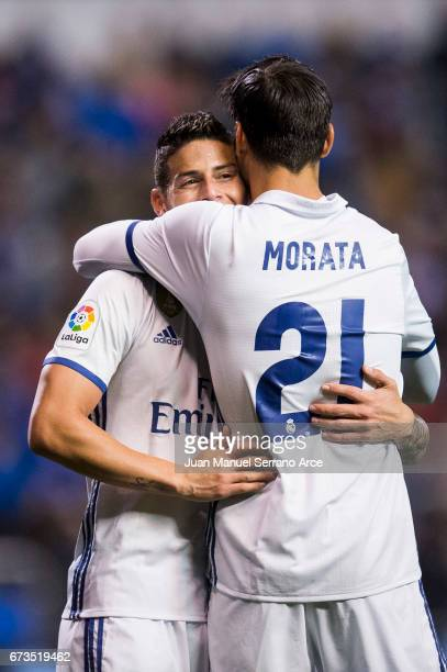 James Rodriguez of Real Madrid celebrates with his teammates Alvaro Morata of Real Madrid after scoring his team's fourth goal during the La Liga...