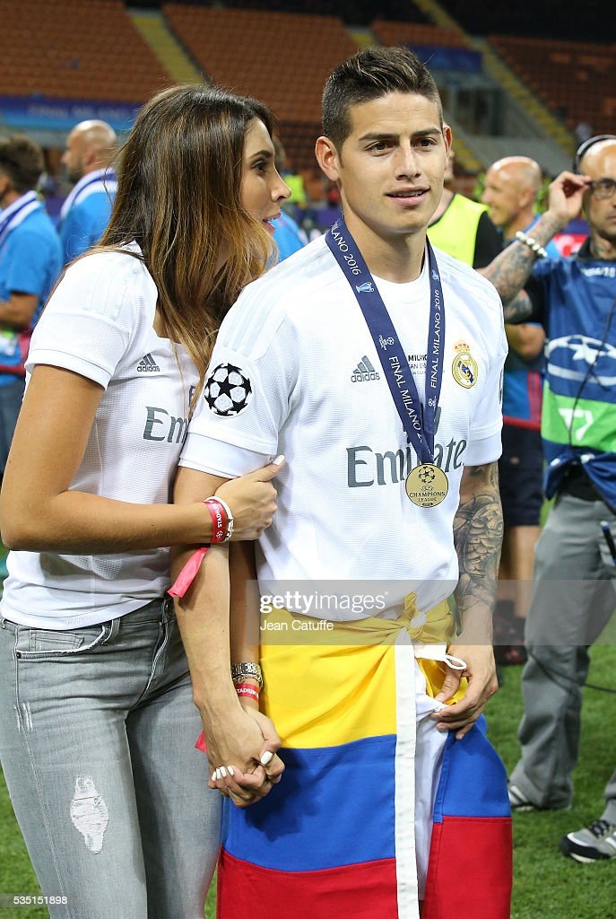 <a gi-track='captionPersonalityLinkClicked' href=/galleries/search?phrase=James+Rodriguez&family=editorial&specificpeople=4422074 ng-click='$event.stopPropagation()'>James Rodriguez</a> of Real Madrid celebrates with his wife <a gi-track='captionPersonalityLinkClicked' href=/galleries/search?phrase=Daniela+Ospina&family=editorial&specificpeople=13410009 ng-click='$event.stopPropagation()'>Daniela Ospina</a> winning the UEFA Champions League final between Real Madrid and Club Atletico Madrid at Stadio Giuseppe Meazza, San Siro on May 28, 2016 in Milan, Italy.