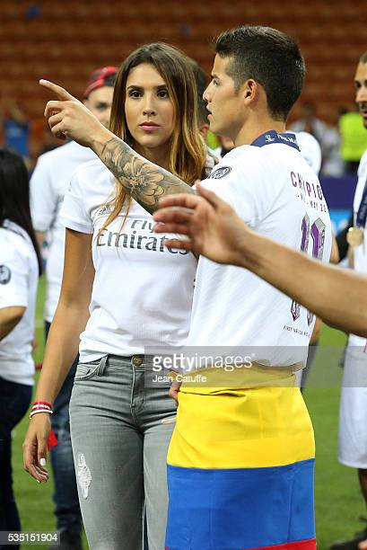 James Rodriguez of Real Madrid celebrates with his wife Daniela Ospina winning the UEFA Champions League final between Real Madrid and Club Atletico...