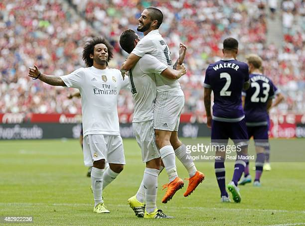 James Rodriguez of Real Madrid celebrates with Isco after scoring the opening goal during the Audi Cup 2015 match between Real Madrid and Tottenham...