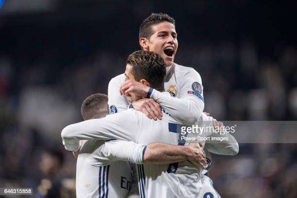 James Rodriguez of Real Madrid celebrates with teammates Daniel Carvajal Ramos and Cristiano Ronaldo during the match Real Madrid vs Napoli part of...