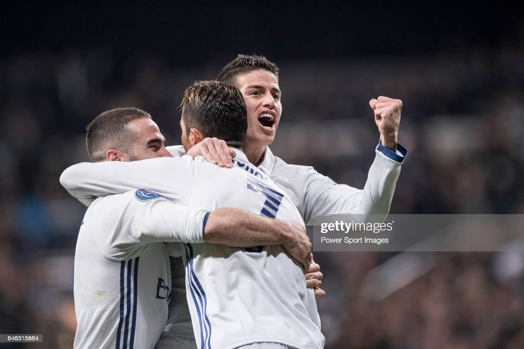James Rodriguez of Real Madrid (raising fist) celebrates with teammates Daniel Carvajal Ramos (left) and Cristiano Ronaldo during the match Real Madrid vs Napoli, part of the 2016-17 UEFA Champions League Round of 16 at the Santiago Bernabeu Stadium on 15 February 2017 in Madrid, Spain.