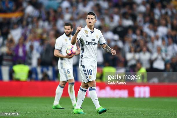 James Rodriguez of Real Madrid CF celebrates after scoring his team's second goal during the La Liga match between Real Madrid CF and FC Barcelona at...