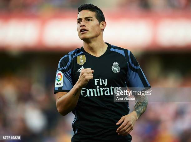 James Rodriguez of Real Madrid CF celebrates after scoring the first goal during the La Liga match between Granada CF v Real Madrid CF at Estadio...