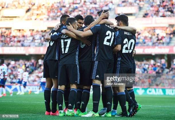 James Rodriguez of Real Madrid CF celebrates after scoring the first goal with his team mates during the La Liga match between Granada CF v Real...
