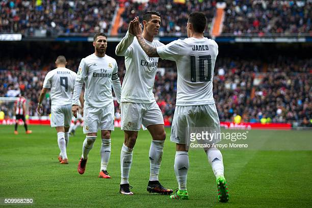 James Rodriguez of Real Madrid CF celebrates scoring their second goal with teammate Cristiano Ronaldo during the La Liga match between Real Madrid...