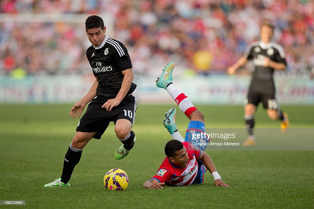 James Rodriguez of Real Madrid CF competes for the ball with Jeison Murillo of Granada CF the La Liga match between Granada CF and Real Madrid CF at...