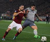 James Rodriguez of Real Madrid CF competes for the ball with Kostas Manolas of AS Roma during the UEFA Champions League round of 16 first leg match...