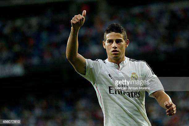 James Rodriguez of Real Madrid CF gives the ok to his teammates during the La Liga match between Real Madrid CF and Elche CF at Estadio Santiago...