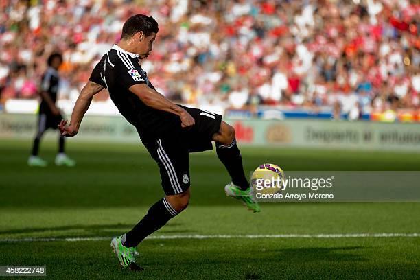James Rodriguez of Real Madrid CF scores their second goalduring the La Liga match between Granada CF and Real Madrid CF at Nuevo Estadio de Los...