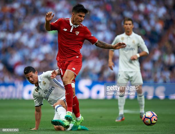James Rodriguez of Real Madrid competes for the ball with Joaquin Correa of Sevilla during the La Liga match between Real Madrid CF and Sevilla CF at...