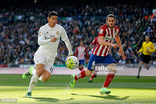James Rodriguez of Real Madrid competes for the ball with Koke of Atletico de Madrid during the La Liga match between Real Madrid CF and Club...