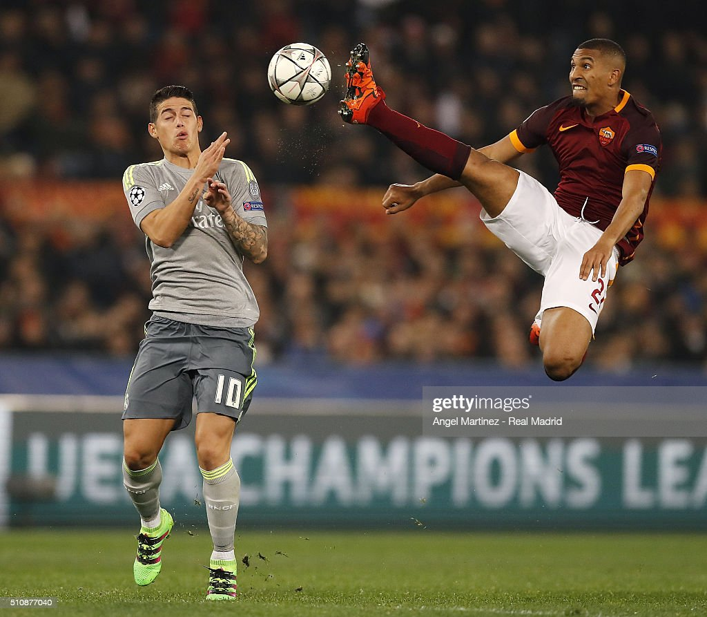 James Rodriguez of Real Madrid competes for the ball with William Vainqueur of AS Roma during the UEFA Champions League Round of 16 First Leg match between AS Roma and Real Madrid CF at Stadio Olimpico on February 17, 2016 in Rome, Italy.