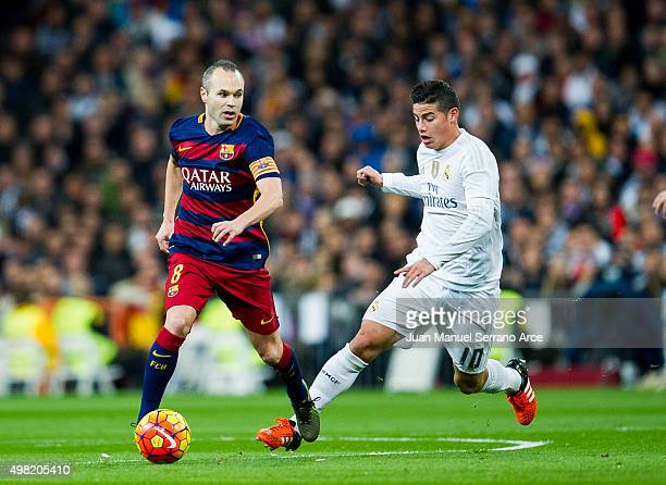 James Rodriguez of Real Madrid duels for the ball with Andres Iniesta of Barcelona during the La Liga match between Real Madrid CF and FC Barcelona...
