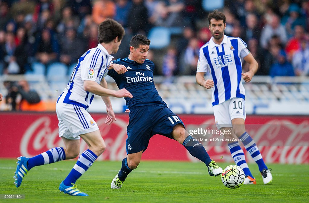 James Rodriguez of Real Madrid duels for the ball with Aritz Elustondo of Real Sociedad during the La Liga match between Real Sociedad de Futbol and Real Madrid at Estadio Anoeta on April 30, 2016 in San Sebastian, Spain.