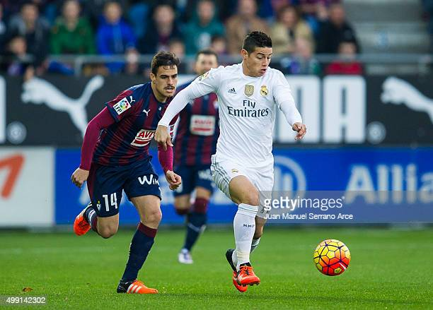 James Rodriguez of Real Madrid duels for the ball with Daniel Garcia of SD Eibar during the La Liga match between SD Eibar and Real Madrid at Ipurua...
