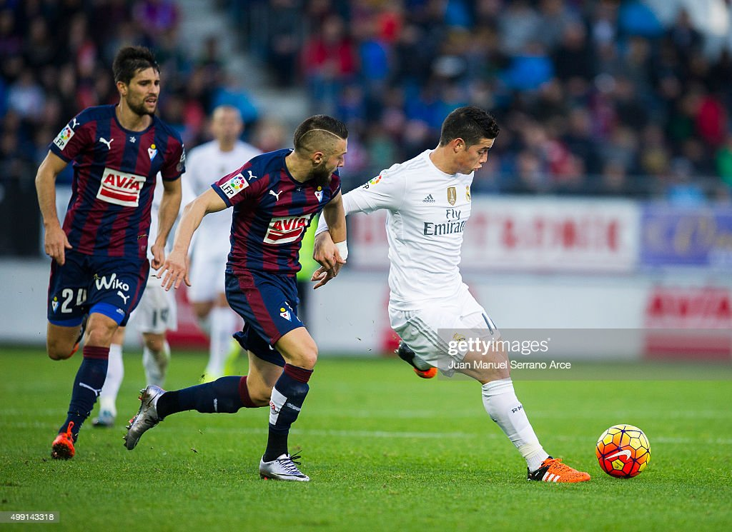 James Rodriguez of Real Madrid duels for the ball with David Junca of SD Eibar during the La Liga match between SD Eibar and Real Madrid at Ipurua Municipal Stadium on November 29, 2015 in Eibar, Spain.