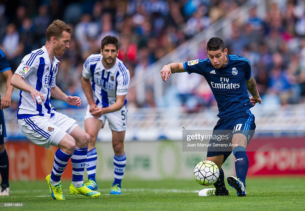 James Rodriguez of Real Madrid duels for the ball with David Zurutuza of Real Sociedad during the La Liga match between Real Sociedad de Futbol and Real Madrid at Estadio Anoeta on April 30, 2016 in San Sebastian, Spain.