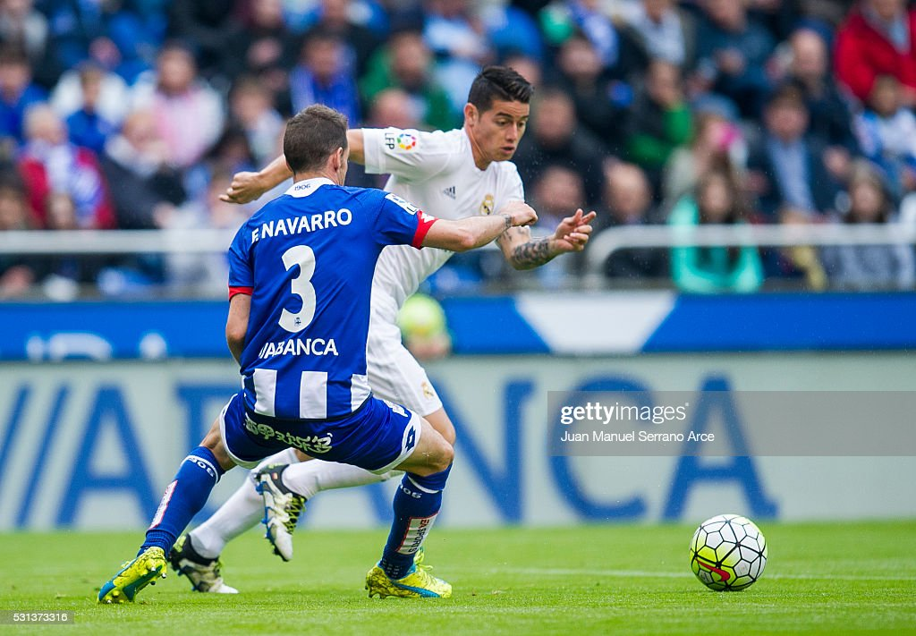 James Rodriguez of Real Madrid duels for the ball with Fernando Navarro of RC Deportivo La Coruna during the La Liga match between RC Deportivo La Coruna and Real Madrid CF at Riazor Stadium on May 14, 2016 in La Coruna, Spain.