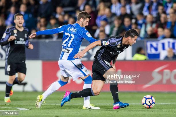 James Rodriguez of Real Madrid fights for the ball with Ruben Perez of Deportivo Leganes during their La Liga match between Deportivo Leganes and...