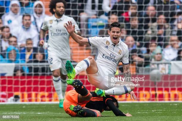 James Rodriguez of Real Madrid gets tripped by Daniel Parejo Munoz of Valencia CF during their La Liga match between Real Madrid and Valencia CF at...