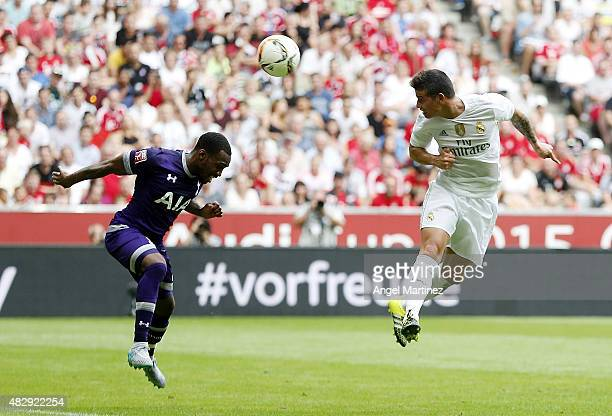 James Rodriguez of Real Madrid heads the ball to score the opening goal during the Audi Cup 2015 match between Real Madrid and Tottenham Hotspur at...