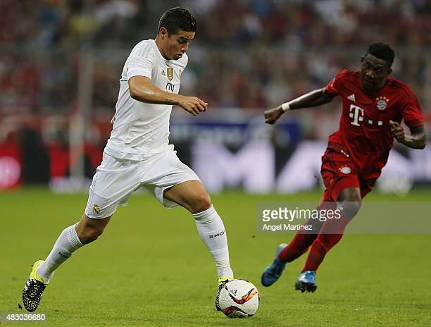 James Rodriguez of Real Madrid is chased by David Alaba of FC Bayern Munich during the Audi Cup 2015 match between FC Bayern Muenchen and Real Madrid...
