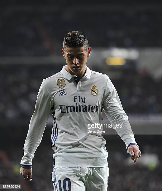 James Rodriguez of Real Madrid looks down during the Copa del Rey Round of 16 First Leg match between Real Madrid and Sevilla at Bernabeu on January...