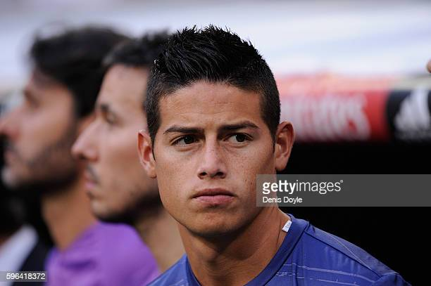 James Rodriguez of Real Madrid looks on from the bench before the La Liga match between Real Madrid CF and RC Celta de Vigo at Estadio Santiago...