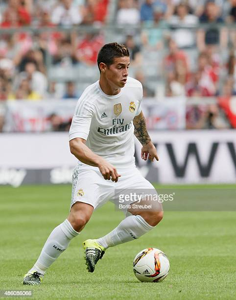 James Rodriguez of Real Madrid runs with the ball during the Audi Cup 2015 match between Real Madrid and Tottenham Hotspur at Allianz Arena on August...
