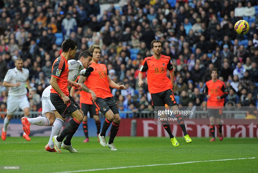 James Rodriguez of Real Madrid scores the opening goal during the La Liga match between Real Madrid CF and Real Sociedad de Futbol at Estadio Santiago Bernabeu on January 31, 2015 in Madrid, Spain.