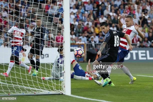 James Rodriguez of Real Madrid scores the opening goal during the La Liga match between Granada CF and Real Madrid CF at Estadio Nuevo Los Carmenes...