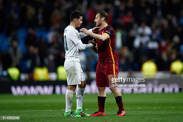 James Rodriguez of Real Madrid shakes hands with Francesco Totti of Roma after the UEFA Champions League Round of 16 Second Leg match between Real...