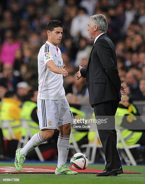 James Rodriguez of Real Madrid shakes hands with his head coach Carlos Ancelotti after being substituted during the Copa Del Rey Round of 32 Second...