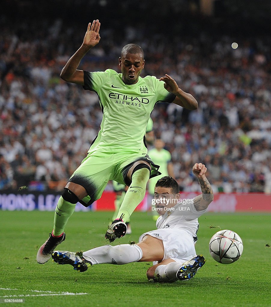 James Rodriguez of Real Madrid tries to shoot past Fernandinho of Manchester City during the UEFA Champions League Semi Final second leg match between Real Madrid and Manchester City FC at Estadio Santiago Bernabeu on May 4, 2016 in Madrid, Spain.