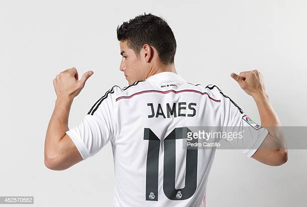 James Rodriguez poses during his official unveiling as a new Real Madrid player at Estadio Santiago Bernabeu on July 22 2014 in Madrid Spain